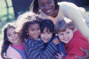 teacher with four students
