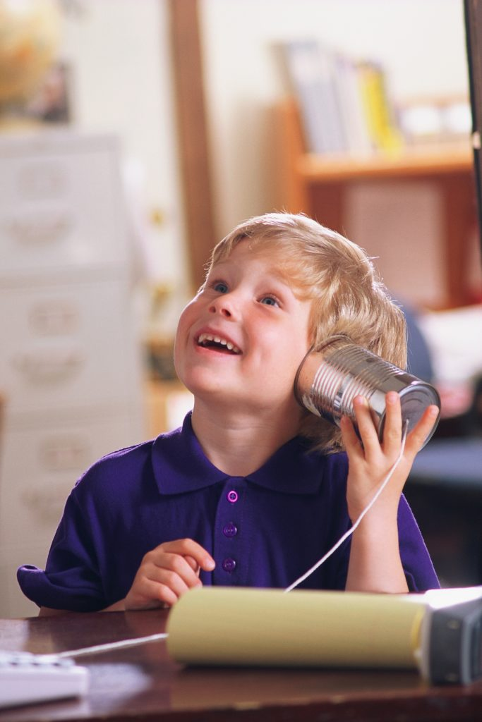 Boy with tin can phone