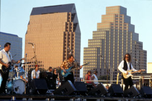 Musicians in front of skyline