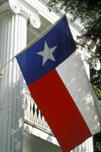 TX flag in front of governor's mansion